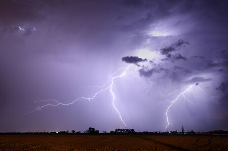 rain weather: Storm with lightning in landscape