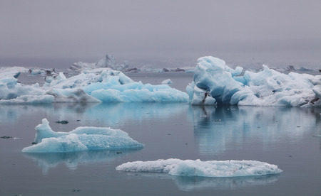 Blue icebergs floating in Jokulsarlon glacial lagook, Iceland photo