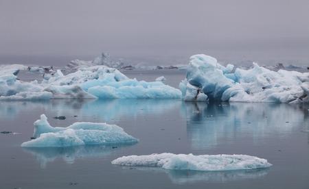 Blue icebergs floating in Jokulsarlon glacial lagook, Iceland photo