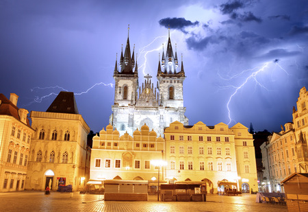 Prague Old town square, Tyn Cathedral at storm photo