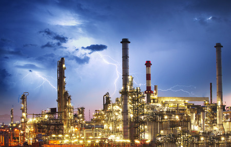 Oil indutry refinery - factory with lightning Stock Photo