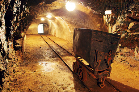 railway history: Underground train in mine, carts in gold, silver and copper mine.