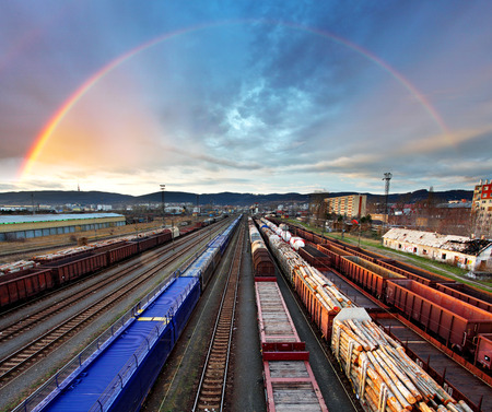 railway transportation: Train Freight transportation with rainbow - Cargo transit