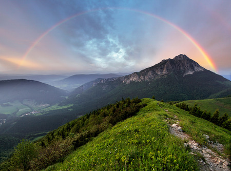 mountains and sky: Rainbow over mountain peak