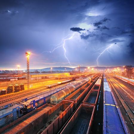 goods train: Train Freight transportation at storm - Cargo transit Stock Photo