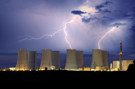 Nuclear power plant at storm photo