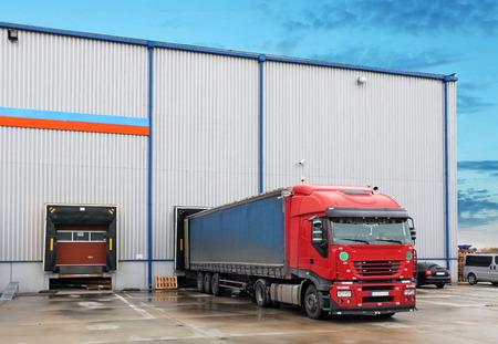 Cargo truck at warehouse building Stok Fotoğraf - 35618822