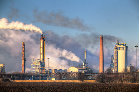 oil pollution: Factory with air pollution Stock Photo