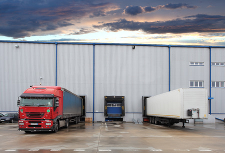 loading bay: Cargo truck at warehouse building