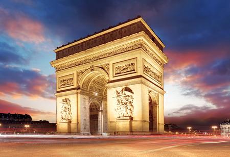 night traffic: Paris, Famous Arc de Triumph at evening , France Stock Photo