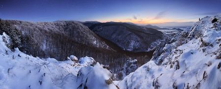 Panorama at night mountain with man photo