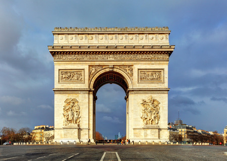 Arc de Triomphe: Arch of Triumph (Arc de Triomphe) with dramatic sky, Paris, France