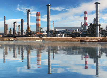 Petrochemical plant with reflection in water, Oil Industry photo