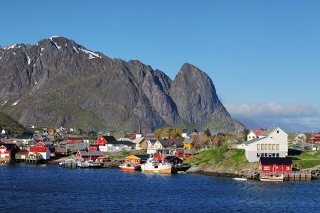 rorbu: Norwegian fishing village with traditional red rorbu huts, Reine, Lofoten Islands, Norway