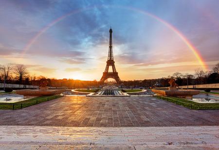 paris street: Rainbow over Eiffel tower, Paris Stock Photo