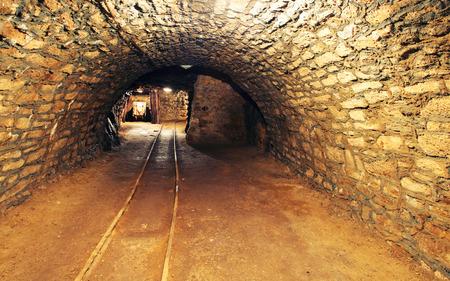 mining gold: Mine gold underground tunnel railroad Stock Photo