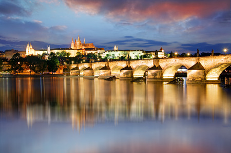 charles: Prague castle and Charles bridge at night Stock Photo