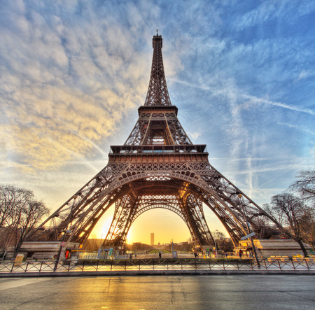 Wide shot of Eiffel Tower with dramatic sky Paris France