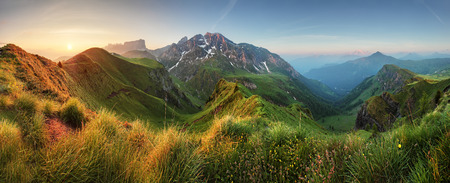 Mountain sunrise panorama in Dolomites Passo Giau