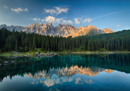 Lake with mountain forest landscape Lago di Carezza