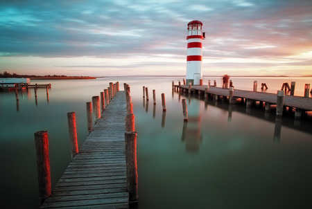 lighthouse with beam: Lighthouse at Lake Neusiedl at sunset