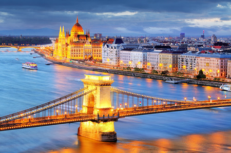 obuda: Budapest, night view of Chain Bridge on the Danube river and the city of Pest Editorial