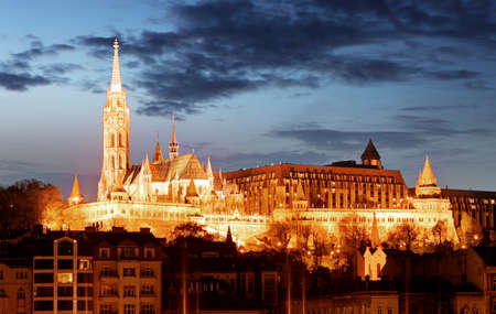 fisherman: Matthias Church and Fishermans Bastion over the Danube river at night. Budapest, Hungary.