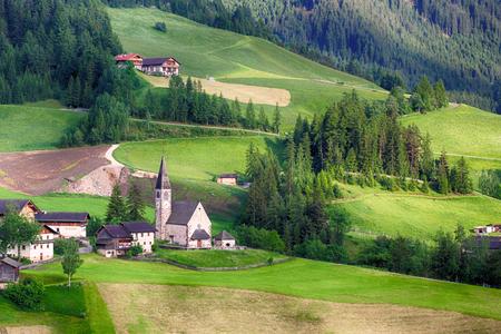 odle: Santa Maddalena Church in Italian Dolomites Alps, Odle, spring landscape Stock Photo