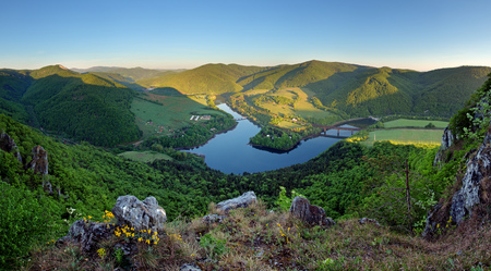 river rocks: Beautiful Slovakian panoramic landscape with a rock and river down in the valley. Kosice area