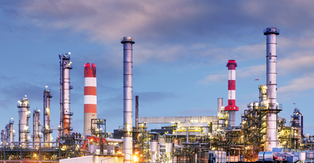 tanks: Oil and gas industry - refinery at twilight - factory - petrochemical plant Stock Photo