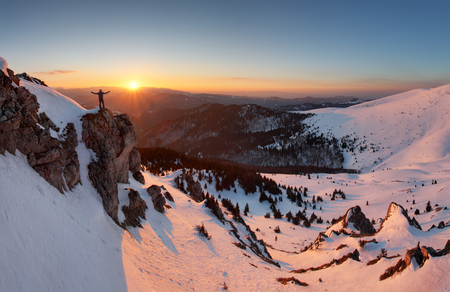 mountain sunset: Man on top as silhouette in mountain
