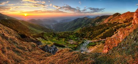 color: Colorful autumn sunset in the mountains.