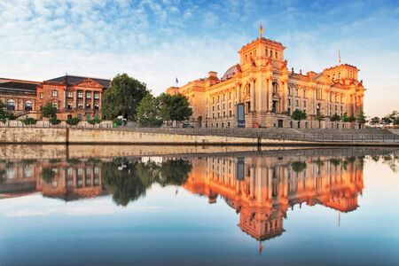 europe travel: Reichstag with reflection in Spree, Berlin