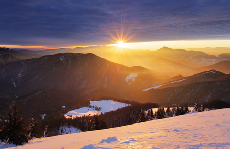 tatras: Sunset over color mountain silhouette with rays