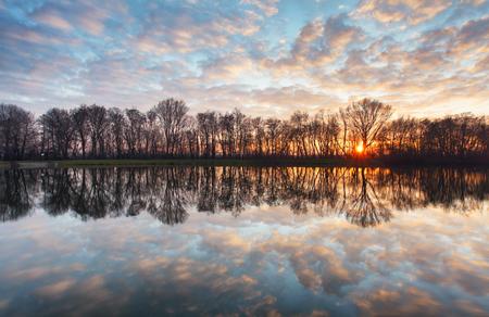 sunset lake: Water reflection at sunrise in lake
