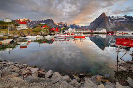 fishing huts: Norway coast with boat and red huts, Reine
