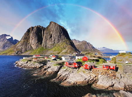 Norwegian fishing village huts with rainbow, Reine, Lofoten Islands, Norway