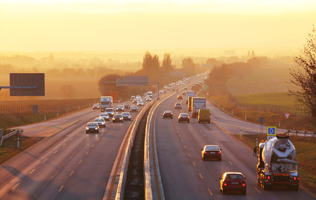 city of sunrise: Traffic on highway with cars. Stock Photo