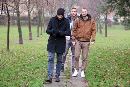 group of men: Three friend in park - men