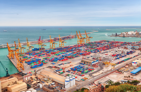 mass storage: Barcelona, Spain - February 9, 2016: View of the cargo port and container terminal of Barcelona with the Montjuic hill. Editorial