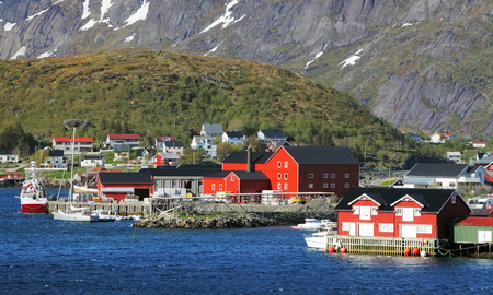 rorbuer: Norway village with mountain - Lofoten, Reine Stock Photo