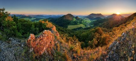 manin: Panorama of forest mountain landscape at sunset