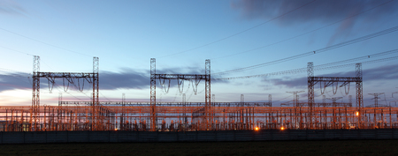 voltage: distribution substation silhouetted against dusk sky ,electricity background Stock Photo