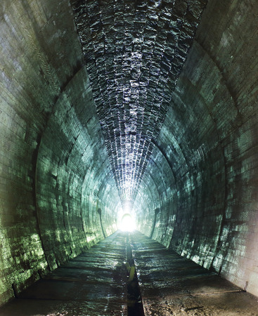 abandoned: Inside of a grungy tunnel