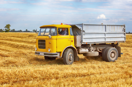 grains: Truck, lorry on field Stock Photo