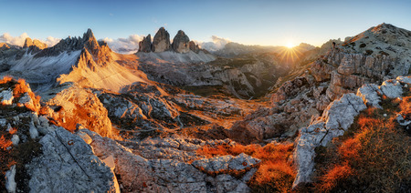 Dolomites mountain panorama in Italy at sunset - Tre Cime di Lavaredo Stock Photo