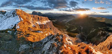 odle: Witner autumn mountain at sunset, Val Gardena from peak Seceda, Dolomites. Stock Photo