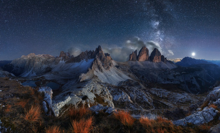 Alps Mountain landscape with night sky and Mliky way, Tre Cime di Lavaredo, Dolomites