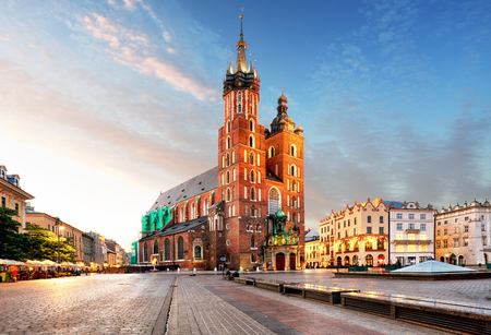 Old city center view with Adam Mickiewicz monument and St. Marys Basilica in Krakow