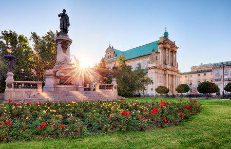 krakowskie przedmiescie: Warsaw - Adam Mickiewicz monument at Krakowskie Przedmiescie Street, Poland Editorial